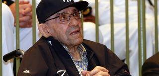 Baseball Hall of Famer Yogi Berra looks on