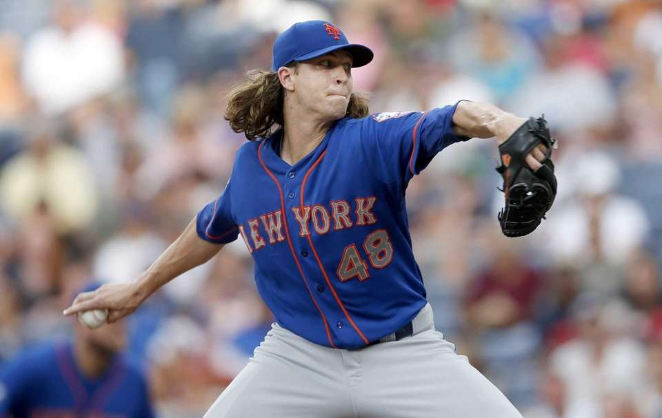 Mets starting pitcher Jacob deGrom works in the