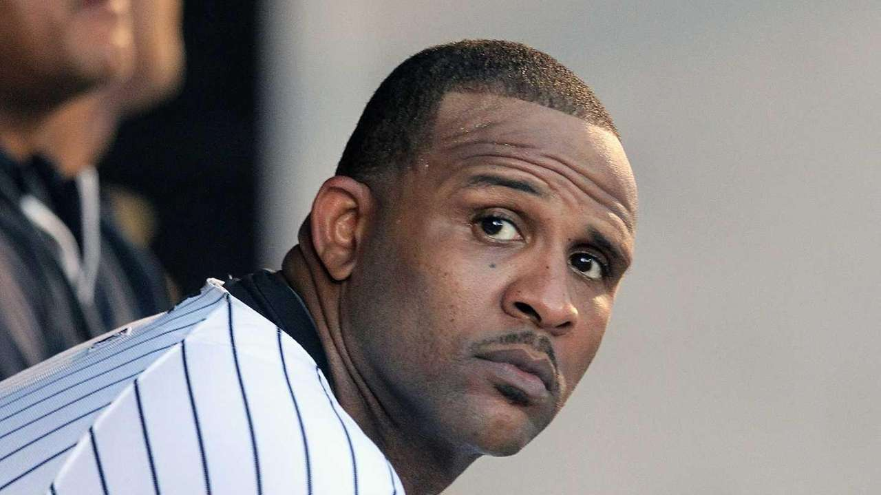 Yankees starter CC Sabathia watches from the dugout