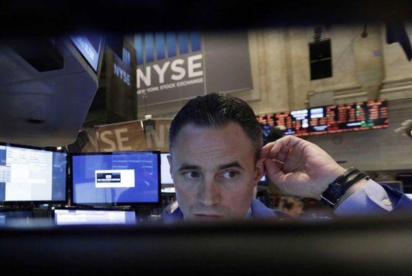 Specialist Jason Hardzewicz is framed by the monitors