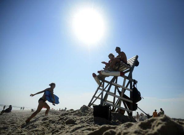 Lifeguards Kristie Hirten and Carl Nowicki sit atop