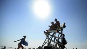 Lifeguards Kristie Hirten and Carl Nowicki sit atop