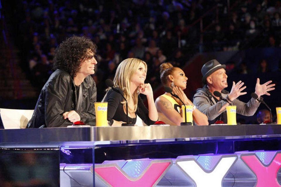 From left, judges Howard Stern, Heidi Klum, Mel