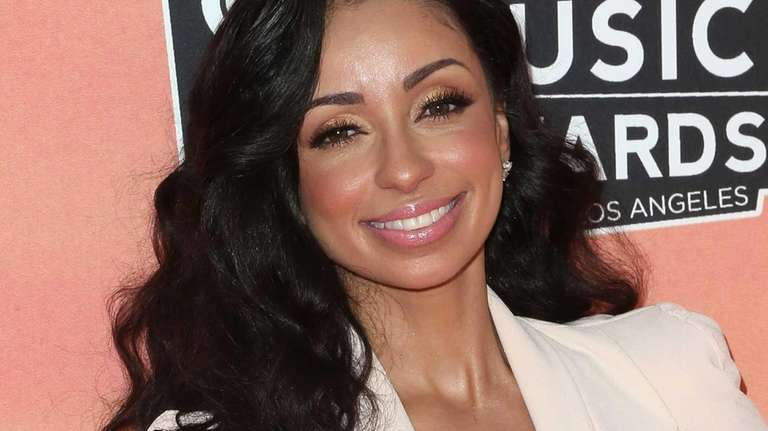 Singer Mya attends the 2014 iHeartRadio Music Awards