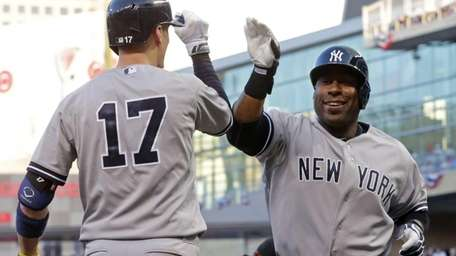 The Yankees' Zelous Wheeler, right, is all smiles