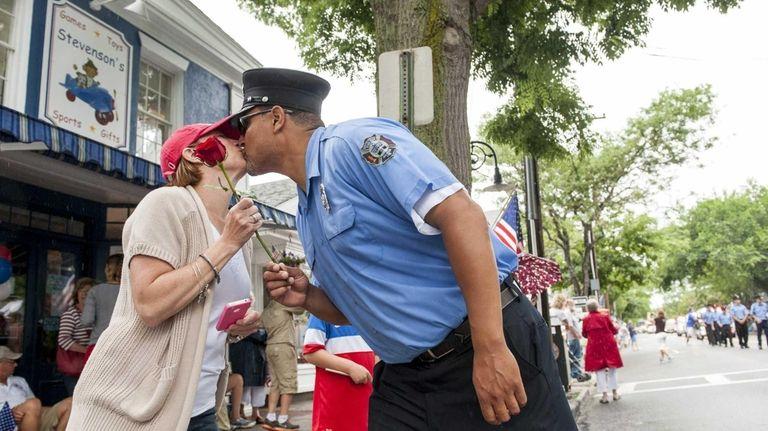 Southampton volunteer firefighter Edgar Franklin gives a rose