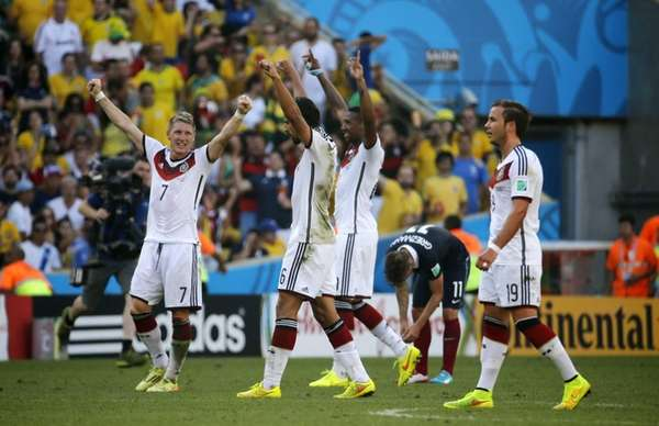 German players celebrate as France's Antoine Griezmann, second