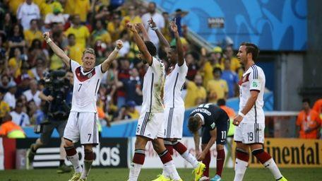 German players celebrate as France's Antoine Griezmann, second