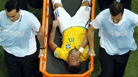 Brazil's Neymar is carried away on a stretcher