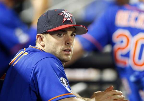 David Wright of the Mets looks on during