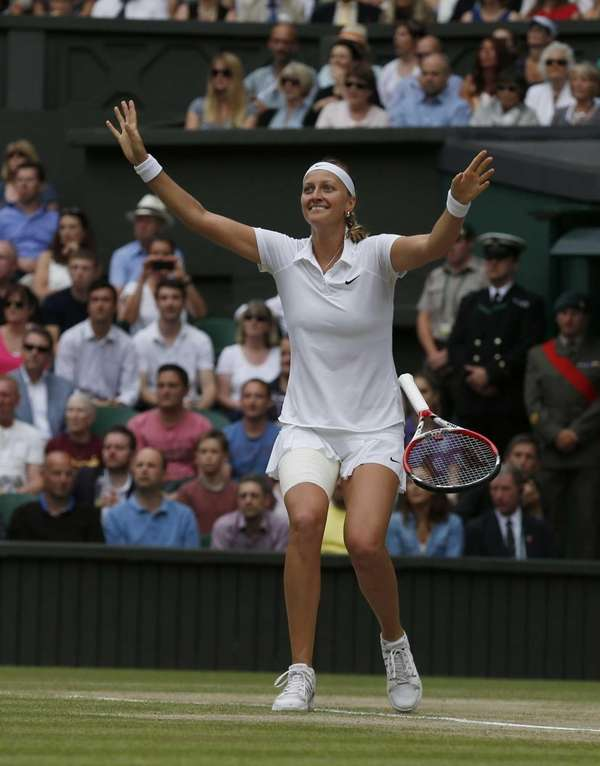 Petra Kvitova of the Czech Republic celebrates defeating