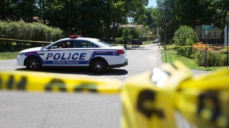 Suffolk County police block traffic near Wyman Avenue