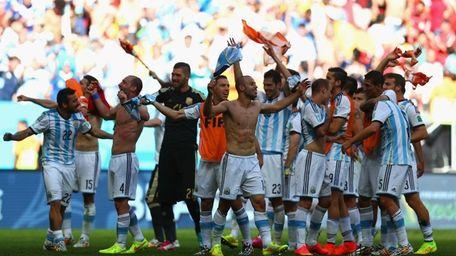 Argentina celebrate defeating Belgium 1-0 during the 2014