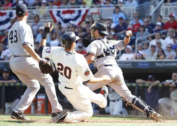 Yankees catcher Francisco Cervelli, right, turns to throw