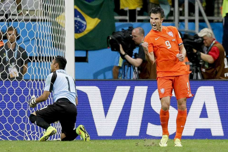 Netherlands' Robin van Persie celebrates after scoring in