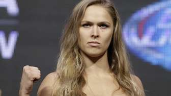 Ronda Rousey poses for photographers during a weigh-in