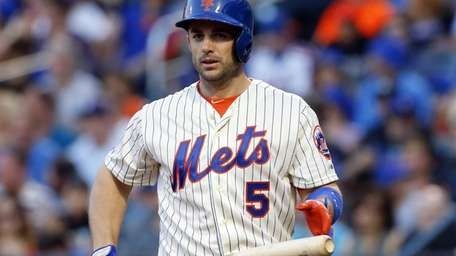 David Wright of the Mets walks to the