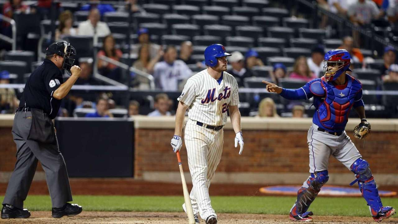 Daniel Murphy of the Mets strikes out to