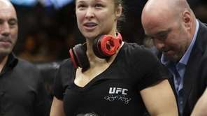 Ronda Rousey looks up after defeating Alexis Davis