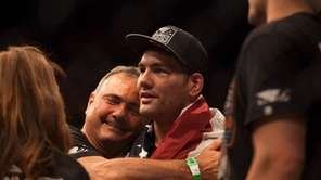 Chris Weidman celebrates his victory over Lyoto Machida