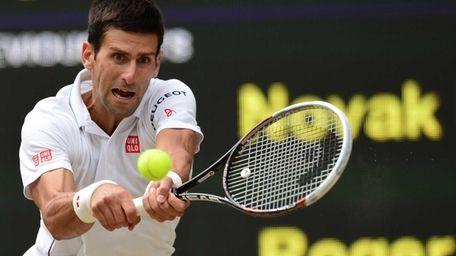Serbia's Novak Djokovic returns to Switzerland's Roger Federer