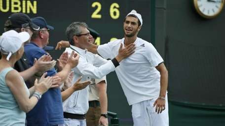 Noah Rubin is congratulated after defeating Stefan Kozlov