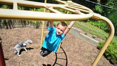Aaron Evangelista, 7, of Woodstock, Connecticut, plays on