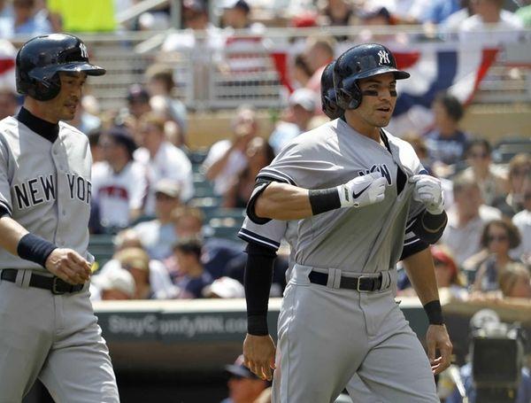 The Yankees' Jacoby Ellsbury gestures to his teammates