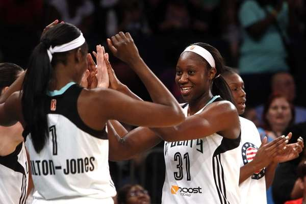Liberty's Tina Charles (31) celebrates after coming out