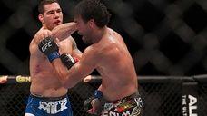 UFC middleweight champion Chris Weidman, from Baldwin, successfully