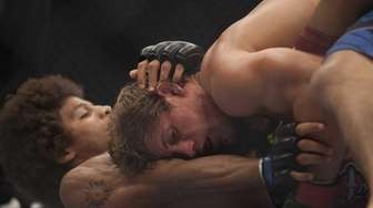 Urijah Faber submitted Alex Caceres by rear naked