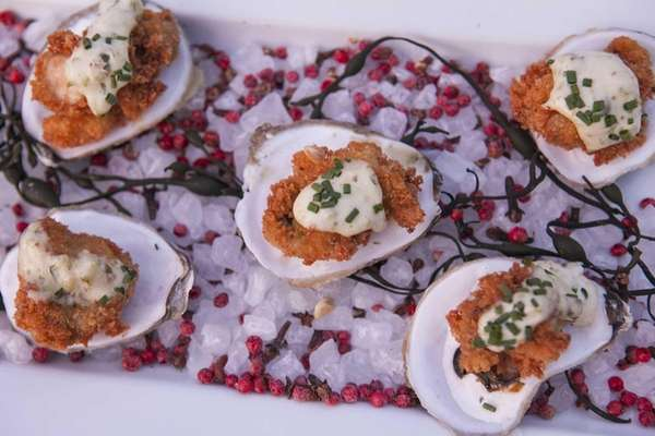 Fried oysters are served on the half shell
