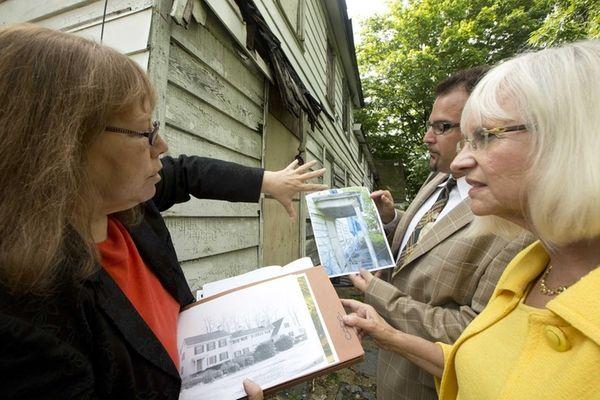 Linda Brickman, deputy commissioner of planning, holds a
