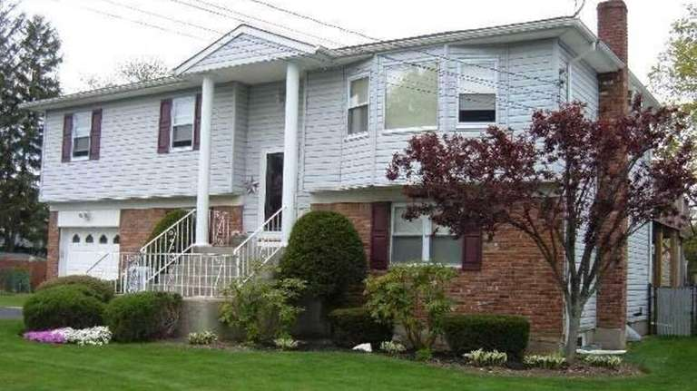 Set on a landscaped 75-by-100-foot property with a
