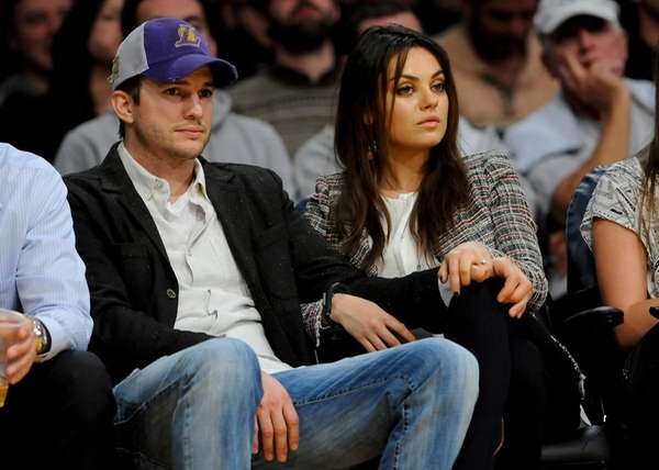 Ashton Kutcher and Mila Kunis attend an NBA