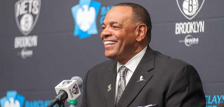 Nets head coach Lionel Hollins talks to reporters