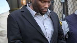 Accused cop killer Darrell Fuller leaves the Nassau