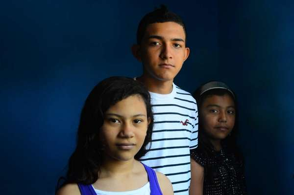 (L-R) Anyeli Rojas, 13, her brother Saul Martinez,