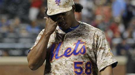 Mets pitcher Jenrry Mejia walks to the dugout