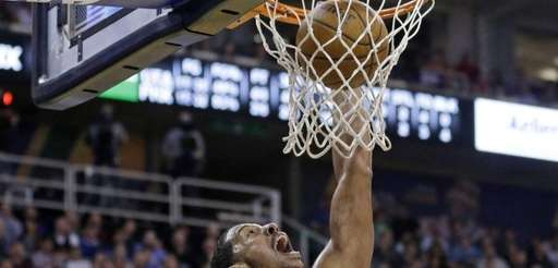 The Phoenix Suns' Channing Frye dunks the ball