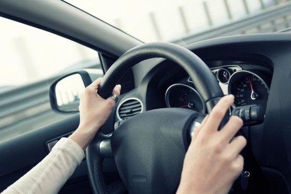 Behind the wheel.