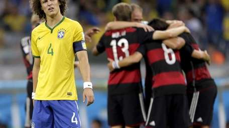 Brazil's David Luiz reacts after Germany's Sami Khedira