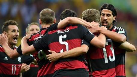 Germany's forward Thomas Mueller, second from right, celebrates