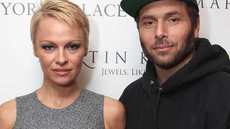 Pamela Anderson and Rick Salomon attend The Martin