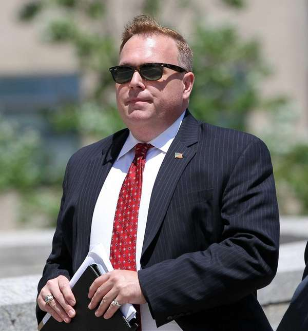 Former Councilman Dan Halloran enters U.S. District Court
