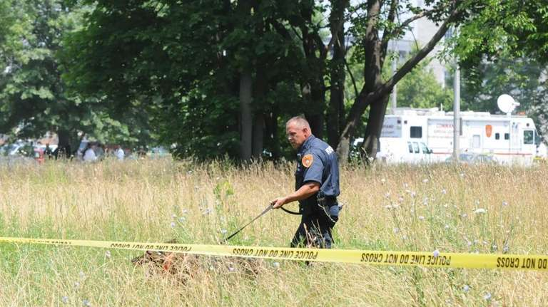 A Suffolk County police search dog investigates the