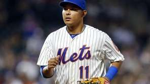 Ruben Tejada of the Mets runs off the