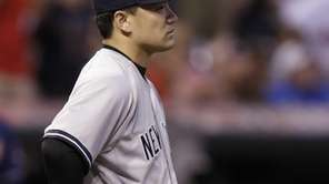 Yankees starting pitcher Masahiro Tanaka watches the ball