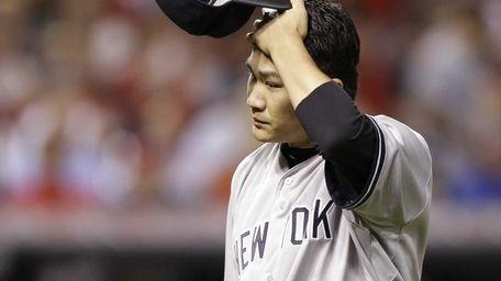 Yankees starting pitcher Masahiro Tanaka walks to the