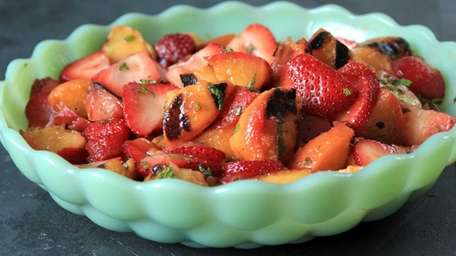 Firm peaches are grilled and tossed with strawberries,